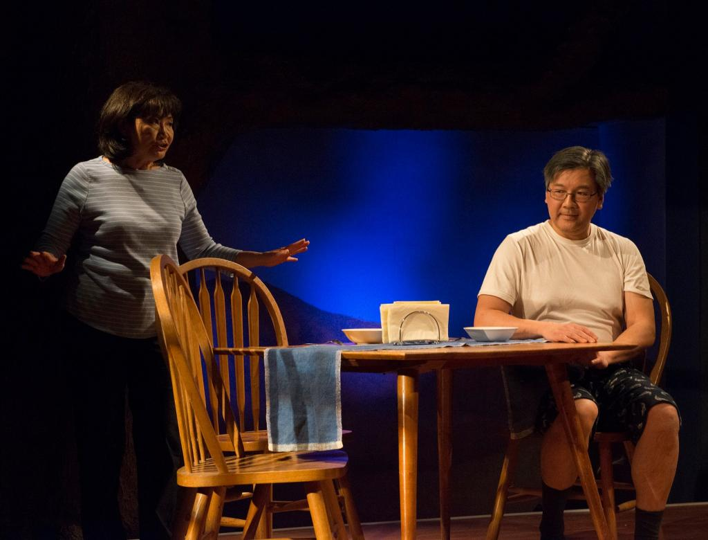 Cheryl Hamada as Mary Chun and Joe Yau as Min Suk Chun in Halcyon Theatre and A-Squared Theatre's co-production of AMERICAN HWANGAP, photo by Marivi Ortiz.