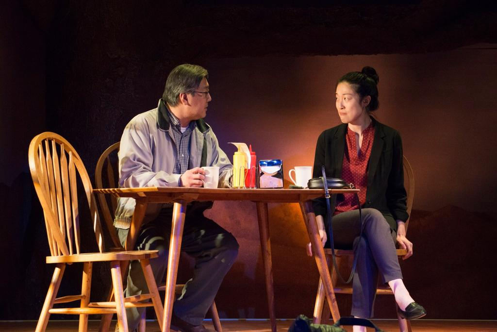 Joe Yau as Min Suk Chun and Helen Joo Lee as Esther Chun in Halcyon Theatre and A-Squared Theatre's co-production of AMERICAN HWANGAP, photo by Marivi Ortiz.